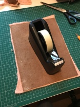 Weighing down while glue dries